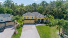 Photo of 2367 Stewarts Cove Way, ORLANDO, FL 32828 (MLS # J915430)