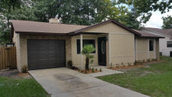 Photo of 3514 Falling Leaf Lane, ORLANDO, FL 32810 (MLS # O5388997)