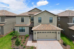 Photo of 1417 Rolling Fairway Drive, CHAMPIONS GATE, FL 33896 (MLS # O5707769)
