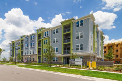 Photo of 7517 Laureate Boulevard, Unit 4202, ORLANDO, FL 32827 (MLS # O5721941)