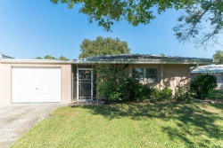 Photo of 3116 Village Green Drive, Unit 1122, SARASOTA, FL 34239 (MLS # O5758402)