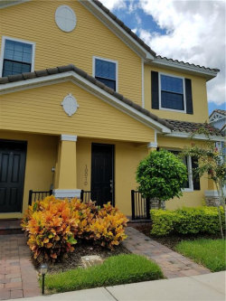 Photo of 10010 Eagle Creek Center Boulevard, ORLANDO, FL 32832 (MLS # O5807922)