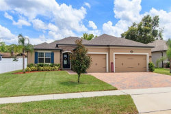 Photo of 628 Fosters Grove Loop, OVIEDO, FL 32765 (MLS # O5876197)