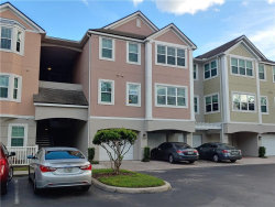 Photo of 6412 Queens Borough Avenue, Unit 211, ORLANDO, FL 32835 (MLS # O5894362)