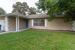 Photo of 7529 Holiday Drive, SPRING HILL, FL 34606 (MLS # T3265468)