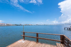 Photo of 1340 Boca Ciega Isle Drive, ST PETE BEACH, FL 33706 (MLS # U7822064)