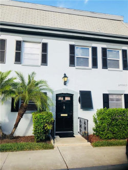 Photo of 6927 PLACE DE LA PAIX , Unit 6927, SOUTH PASADENA, FL 33707 (MLS # U7839532)