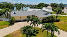Photo of 10001 Paradise Boulevard, TREASURE ISLAND, FL 33706 (MLS # U8047633)