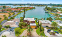 Photo of 10221 Paradise Boulevard, TREASURE ISLAND, FL 33706 (MLS # U8048335)