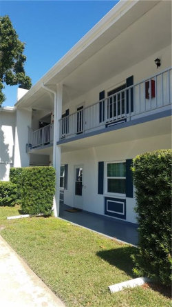 Photo of 600 Glennes Lane, Unit 107, DUNEDIN, FL 34698 (MLS # U8062827)