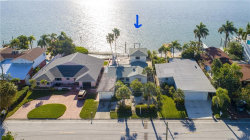 Photo of 724 Boca Ciega Isle Drive, ST PETE BEACH, FL 33706 (MLS # U8068261)
