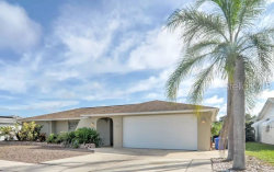 Photo of 1166 Chancellor Drive, HOLIDAY, FL 34690 (MLS # W7813615)