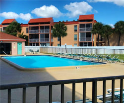 Photo of 8701 Blind Pass Road, Unit 104-B, ST PETE BEACH, FL 33706 (MLS # U8018846)