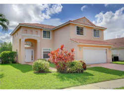 Photo of 424 Southwest 195th Ave, Pembroke Pines, FL 33029 (MLS # A10310901)