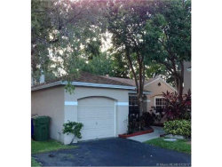 Photo of 11746 Northwest 12th St, Pembroke Pines, FL 33026 (MLS # A10311812)
