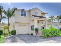 Photo of 12010 Northwest 13 Street, Pembroke Pines, FL 33026 (MLS # A10313405)