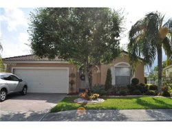 Photo of 990 Northwest 166th Ave, Pembroke Pines, FL 33028 (MLS # A10287322)