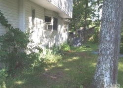 Photo of 272 Cedar Rd, Mastic Beach, NY 11951 (MLS # 2957883)