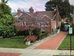 Photo of 79 Olive Dr, Lynbrook, NY 11563 (MLS # 2973627)