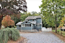 Photo of 50 Cedar Dr, Miller Place, NY 11764 (MLS # 3056578)