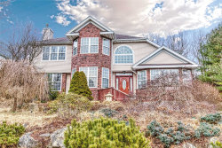 Photo of 26 Whispering Woods Dr, Smithtown, NY 11787 (MLS # 3097076)