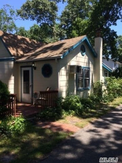 Photo of 109 Moriches Dr, Mastic Beach, NY 11951 (MLS # 3157086)