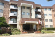 Photo of 3300 N Carriageway Drive, Unit Number 415, ARLINGTON HEIGHTS, IL 60004 (MLS # 09724501)