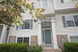 Photo of 113 Enclave Circle, Unit Number D, BOLINGBROOK, IL 60440 (MLS # 09956777)
