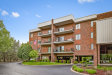 Photo of 6585 Main Street, Unit Number 404, DOWNERS GROVE, IL 60516 (MLS # 09961072)