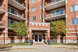 Photo of 455 W Front Street, Unit Number 201, Wheaton, IL 60187 (MLS # 10925742)