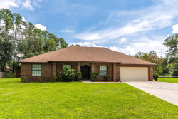 Photo of 506 Timbercrest LN, FLEMING ISLAND, FL 32003 (MLS # 1063556)