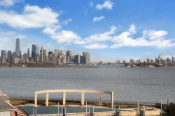 Photo of 110 SHEARWATER CT EAST, Unit 54, Jersey City, NJ 07305 (MLS # 190001405)