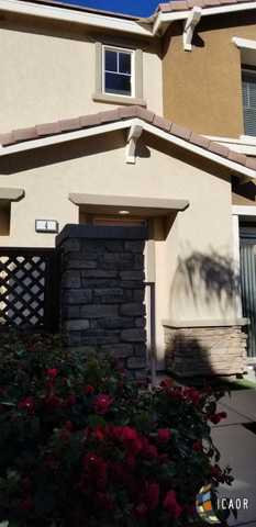 Photo of 315 Breeze Pl, Unit 4, Brawley, CA 92227 (MLS # 18411108IC)